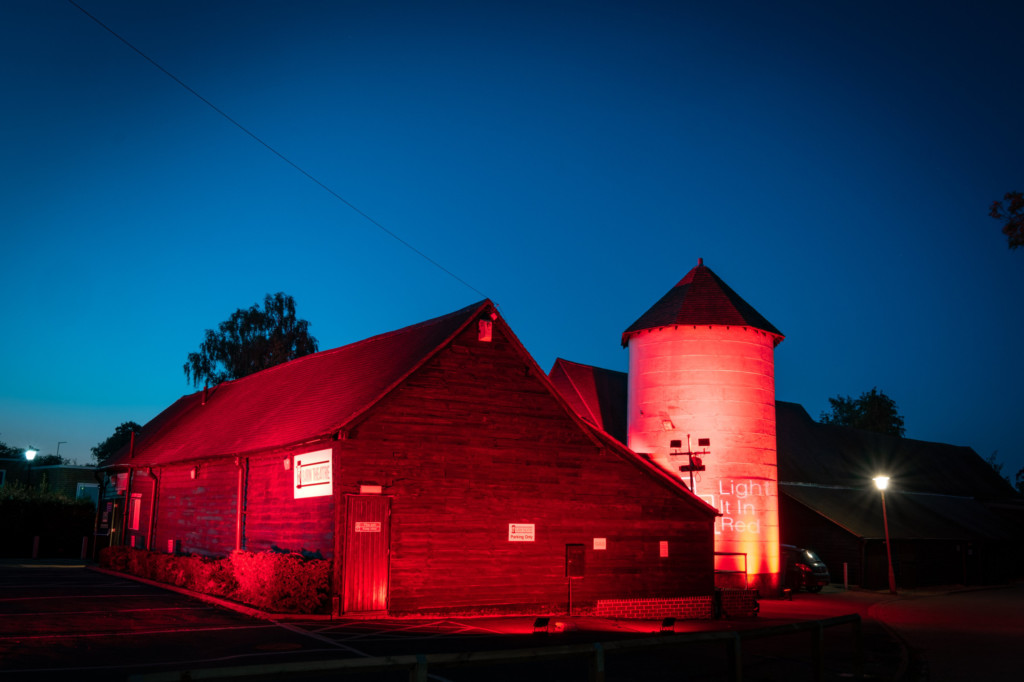 The Barn Theatre in Welwyn Garden City lit up as part of the Light It In Red campaign drawing attent