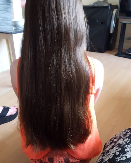 Skye Hubbard had her long hair cut for charity: Pictures: Peter Bullimore
