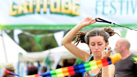 Picture by Daniel Hambury. 18/7/08. A young women with twirl sticks at 'Lattitude', a music and ar