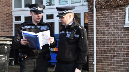 Chief Inspector Nick Paling, right, and PC Adam Binns, outside the first floor flat in Derby Street