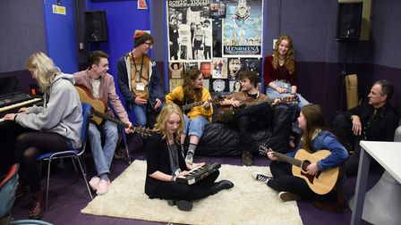 Courtney Pochin, front centre, joins the students at a music class at the Access to Music College, w