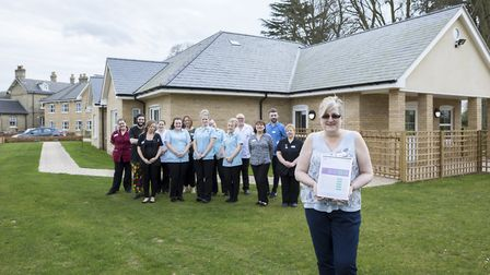 Manager Jenny Daynes stand with her team at Bilney Hall care home, which has received a positive rat
