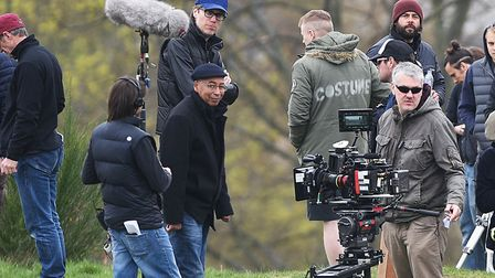 Filming of Fighting With My Family movie on Mousehold Heath. Director Stephen Merchant (left, blue c