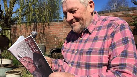 Geoff Martin, from Hethersett, with his new novel, Saint Robert and the Devil. Picgture: Courtesy of