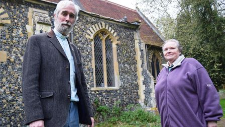 The Rev Canon Stephen Wright and churchwarden Jan Burrow-Wilkes outside St Andrew's Church in Quiden
