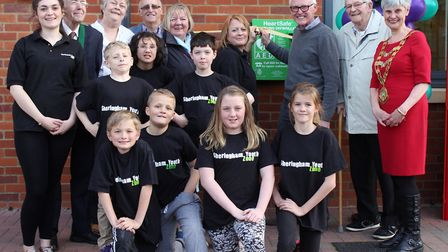 Sheringham Youth Zone founder Julie Chalmers with club members, north Norfolk MP Norman Lamb and tow