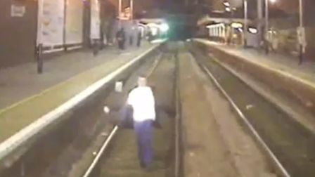 Footage of a man on the tracks in East Anglia. Picture: NETWORK RAIL/BTP
