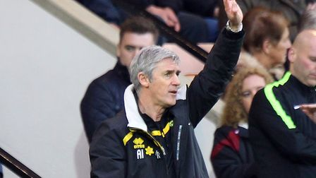 Norwich interim manager Alan Irvine can count on support from ex-Everton team mate Kevin Ratcliffe.