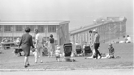 People enjoying the good weather at Hunstanton - Pier in the background pic taken 18th august 1966