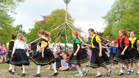 Maypole dancers at the The family May Day Fair at Heigham Park. Picture: Denise Bradley