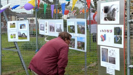 A display of photographs showcasing the project at the ruins of St Margaret's Church, Hopton-on-Sea.