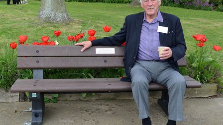 Hopton Parish Council chairman Colin Sykes on the newly unveiled bench at the ruins of St Margaret's