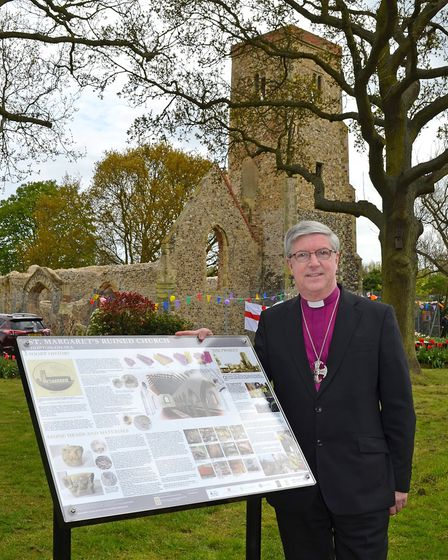 The Lord Bishop of Norwich, The Rt. Revd. Graham James unveils the new information board at the ruin