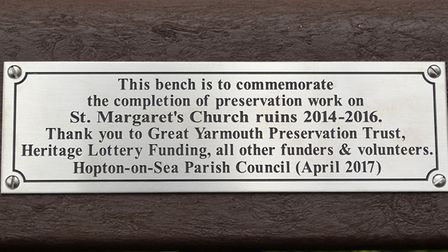 A new bench, featuring a plaque to thank all those involved in the conservation project at the ruins