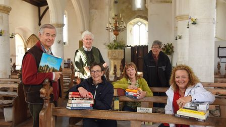The friends of Morston Church are setting up a book sale for this weekend. Pictured are (from left)