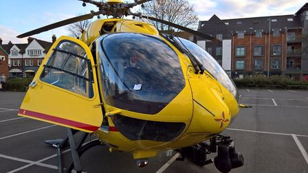 East Anglian Air Ambulance pilot buys pay and display ticket while waiting for patient in Norwich. P