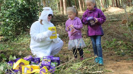 Easter Bunny Donna Welch, who works at Holt Country Park visitor centre, hands out chocolate eggs to