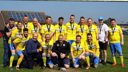 Norwich Sunday League fixture secretary Bernie Hardiman presents the Division 3A trophy to Woolpack