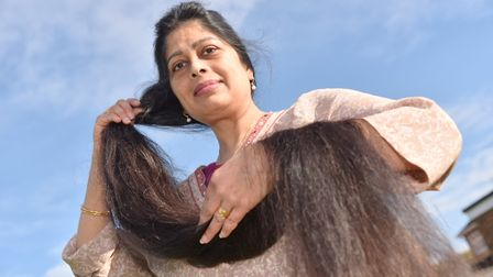 Mina Patel from Diss with her long hair which is she is having cut to raise money for charity. Bylin