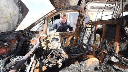Ocean Cabs arson attack. Co-owner Joe Kitchen with the burnt out cars. Picture : ANTONY KELLY