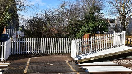 Safety gates have been installed on the rail crossing at Halesworth station. Picture: Nick Butcher.