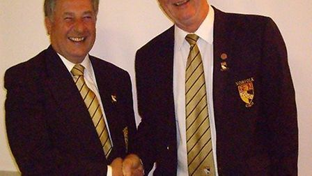 New Norfolk CGU president Graham Turner, left, with the man he has replaced in the important role,.