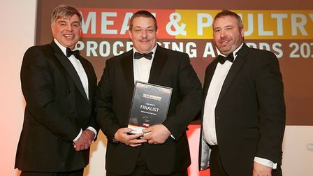 Kevin Burrows (centre) of C&K Meats in Diss at the Meat and Poultry Processing Awards 2015. Picture: