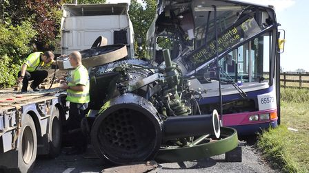 Essex Police investigate the collision on East Mersea Road between a bus and a low-loader lorry whic