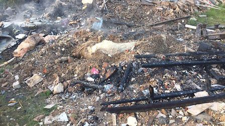 Remains of fire in a field where horses are being kept off the Mundford Road A1066 in Thetford. Pict