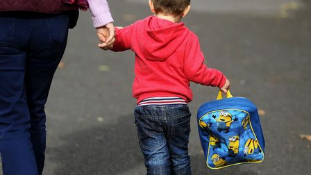 A child on his way to nursery. Picture: Niall Carson/PA Wire