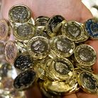 New 12-sided one pound coins at the Royal Mint in Llantrisant, Wales. Picture: Ben Birchall/PA Wire