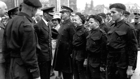 """King George VI talking to young award-winning Norwich hero John Grix (centre): """"I understand you are"""