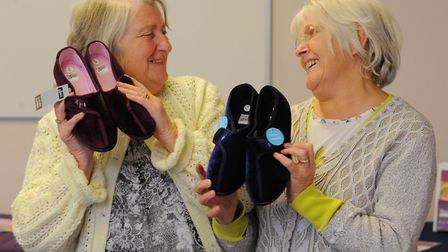 . Julie Richardson and Hazel Bowen with their new slippers at the first slipper swap. Photo : Steve