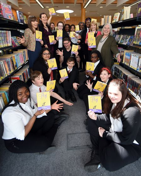 Pupils at the City Academy help with the launch of the programme for the FLY Festival of Literature