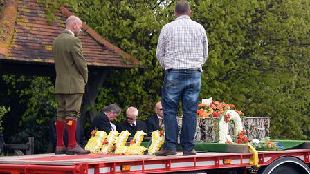 Billy Hines' father, left, on the back of the lorry at his son's funeral at Wortham. PICTURE: Denise