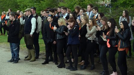 Friends watch as Billy Hines' funeral procession arrives at the church at Wortham. PICTURE: Denise B