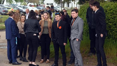 Many of the mourners wear orange, Billy Hines' favourite colour at his funeral at Wortham. PICTURE: