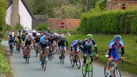 The last corner at the men's road race at Great Thurlow - Liam Gentry (right, VC Baracchi) leads Har