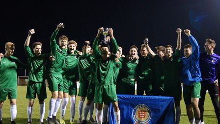 Norfolk's under-18 men's team celebrate winning the East Anglian Counties Championship after a 4-1 w