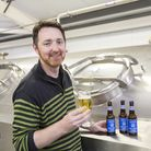 Adnams head brewer Fergus Fitzgerald at the company's brewer in Southwold with Earl Grey Lager. Pic