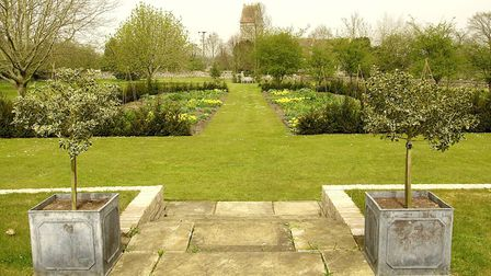 The two long herbacious borders of Wretham Lodge looking straight down to Wretham Church. Photo by