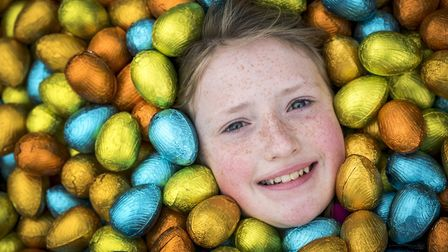 Leah Wightman surrounded by eggs at the hunt in the grounds of Sandringham, one of many Easter event