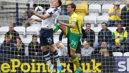 Jordan Hugill of Preston North End and Ryan Bennett of Norwich in action during the Sky Bet Champion
