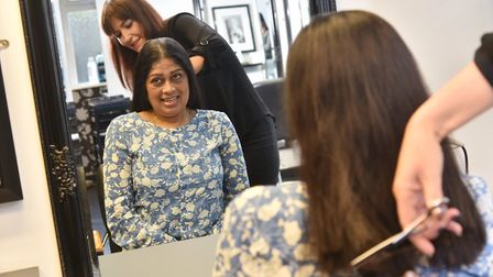 Mina Patel has her really long hair cut for charity at Studio 4 in Diss. Hairdresser Sarah Page is w
