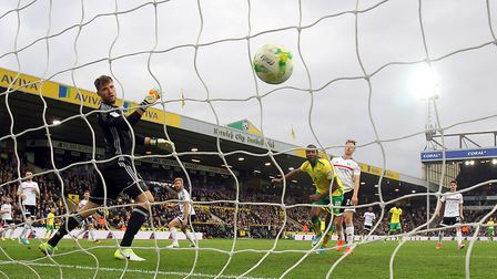 Cameron Jerome heads home what proved to be just a consolation goal against 10-man Fulham at Carrow