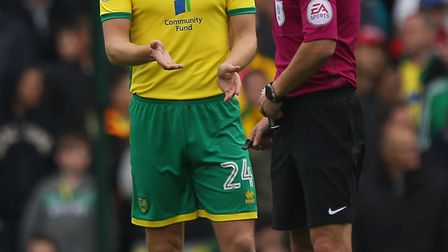Ryan Bennett protests to referee Andrew Madley after giving away a penalty against Fulham. Picture: