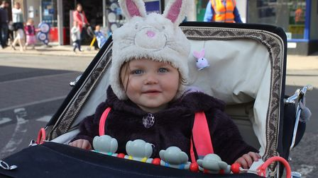 Freya Gurney gets a bird's eye view of the parade from her pram. Picture: KAREN BETHELL