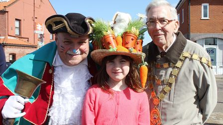 Easter bonnet competition winner Florrie Robbins, 8, with Sheringham mayor David Gooch and town crie