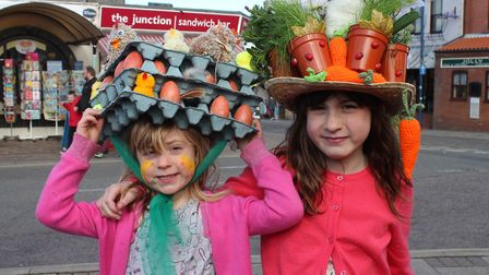 Sisters Polly and Florrie Robbins strike a pose in their Easter bonnets. Picture: KAREN BETHELL