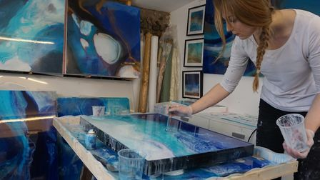Amelia Mills working on her painting for British Airways. Picture: AMELIA MILLS.